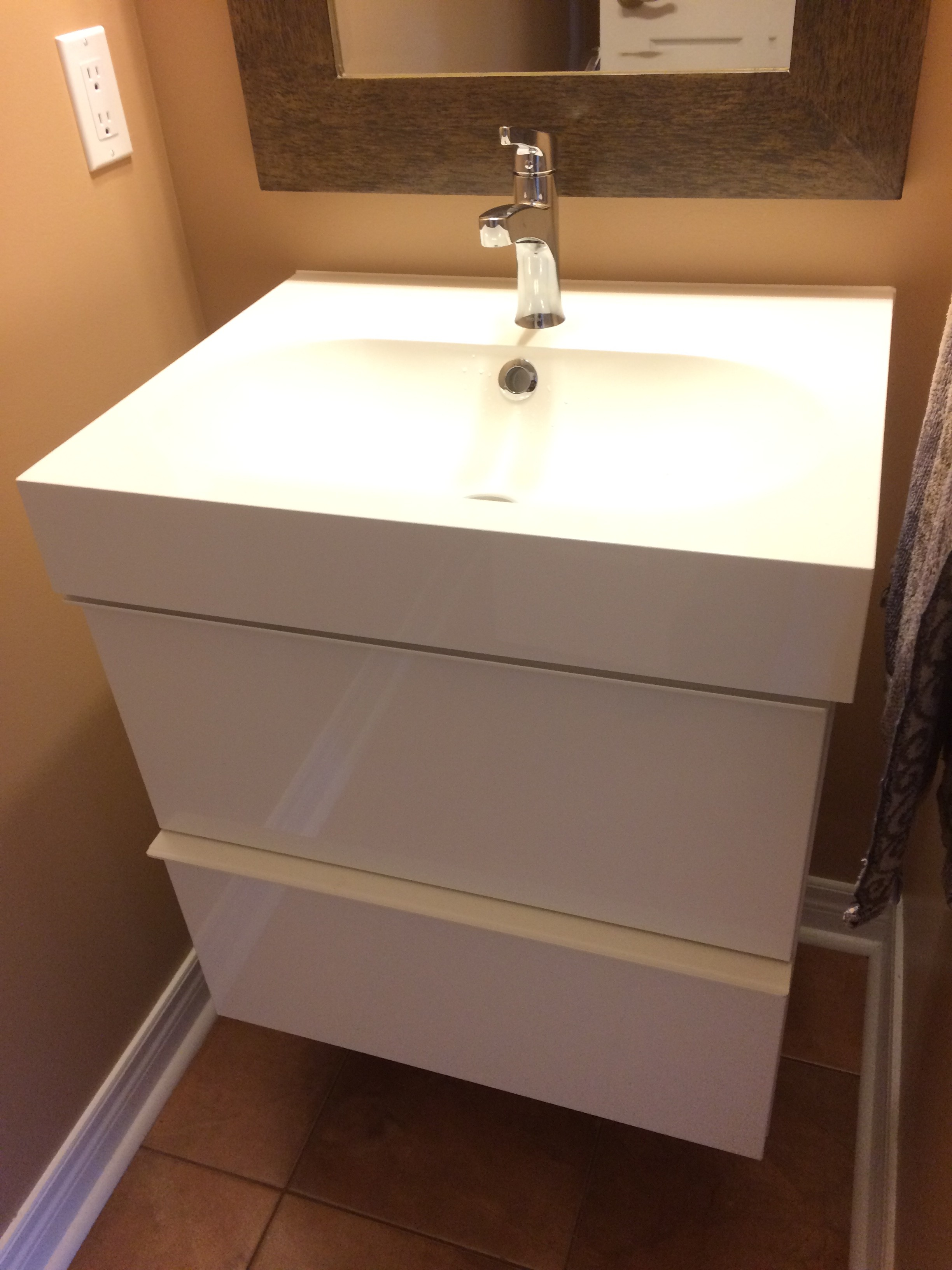 an IKEA. I was hesitant about installing this 'floating' vanity ...
